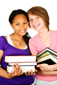 Girls holding text books